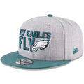 on the left side of the Philadelphia Eagles 2018 NFL Draft On-Stage snapback hat is the New Era logo embroidered in midnight green