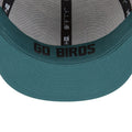 the sweatband and underbrim of the Philadelphia Eagles 2018 NFL Draft snapback hat are midnight green, the sweatband has the word Go Birds printed on the inside of the midnight green sweatband in black