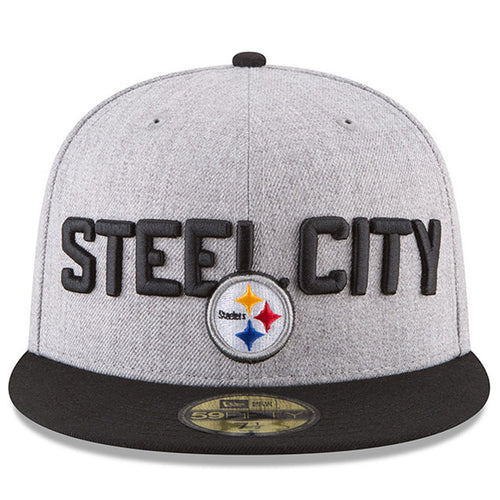 on the front of the pittsburgh steelers new era 59fifty on-stage 2018 nfl draft fitted cap are the words steel city embroidered in black above the pittsburgh steelers logo