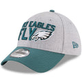 on the left side of the philadelphia eagles 3930 on-stage 2018 nfl draft stretch fit caps is the new era logo embroidered in midnight green