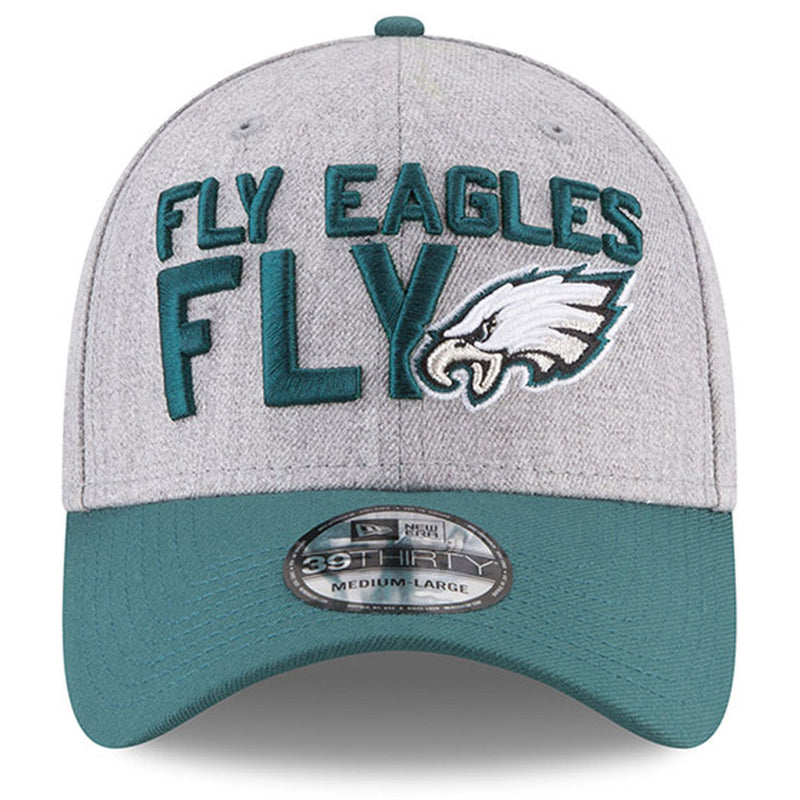 on the front of the 2018 nfl draft philadelphia eagles 3930 flexfit cap are the words fly eagles fly embroidered in midnight green next to the philadelphia eagles logo