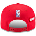 the back of the 2018 houston rockets nba draft on court snapback hat is the nba logo embroidered in red, white, and blue