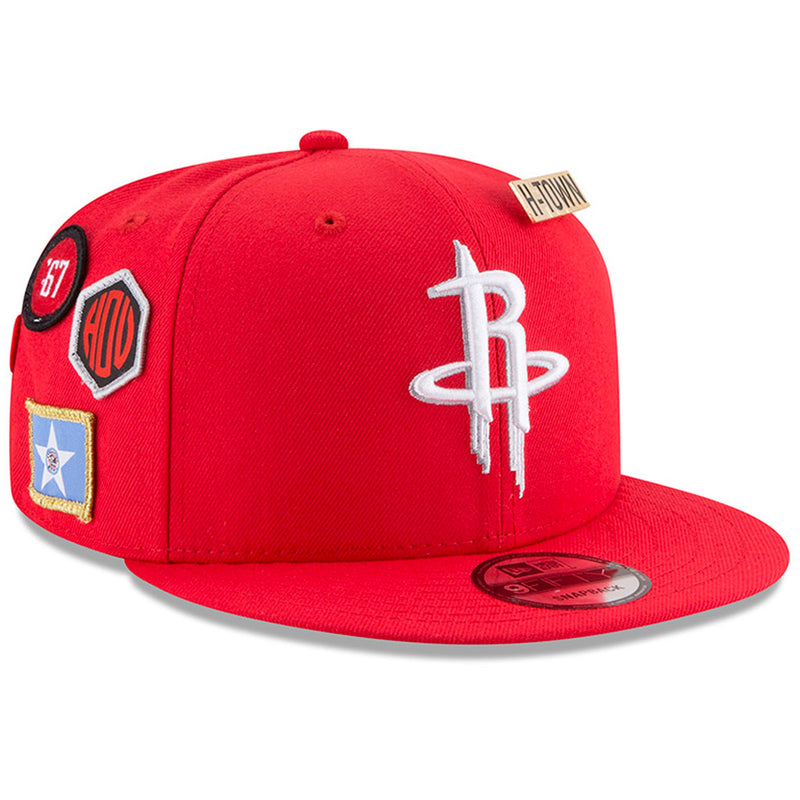 on the front of the houston rockets 2018 nba draft 9fifty snapback hat is the rockets logo embroidered in white