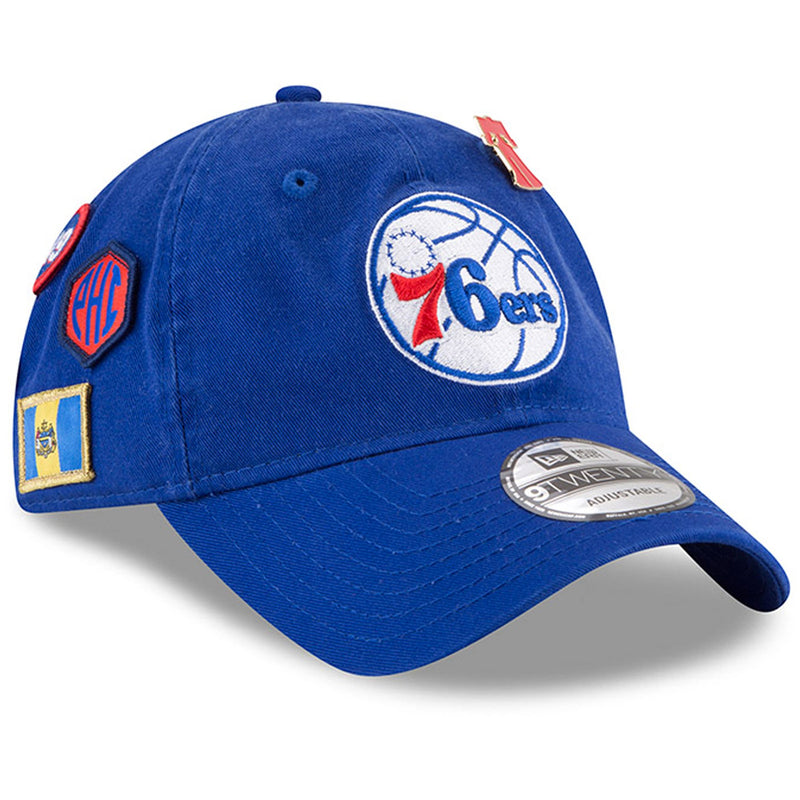 embroidered on the front of 9twenty 2018 nba draft philadelphia 76ers blue dad hat is an image of the philadelphia 76ers logo in white, blue, and red
