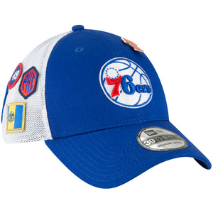 embroidered on the front of the philadelphia 76ers 2018 draft stretch fit cap is the philadelphia 76ers logo embroidered in red, white, and blue