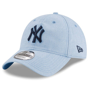 on the front of the youth sized new york yankees father's day on-field dad hat is the yankees logo embroidered in blue