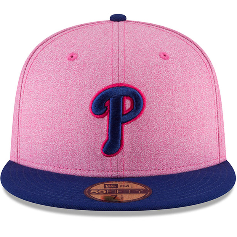 on the front of the 2018 mother's day philadelphia phillies 5950 fitted cap is a phillies logo embroidered in navy blue with a pink outline