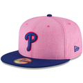 the 2018 mother's day 5950 fitted cap has a high structured heather pink crown and a flat navy blue brim