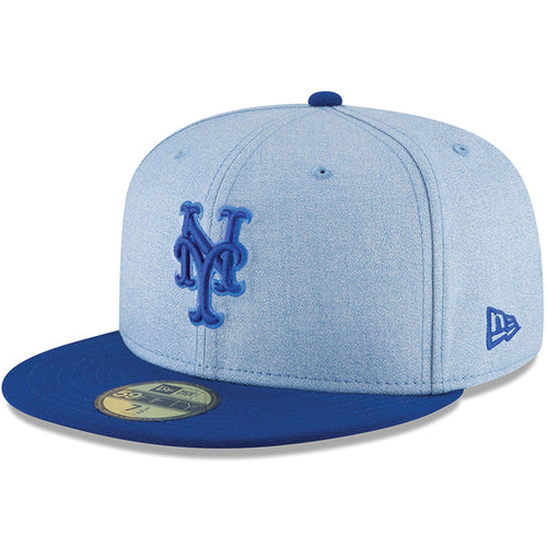 on the front of the new york mets on-field father's day fitted cap is the new york mets logo embroidered in blue with the new era logo embroidered on the wearer's left side in blue