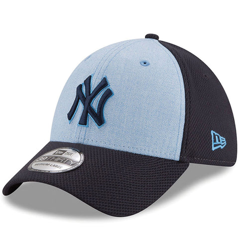on the front of the new york yankees 39thirty 2018 father's day stretch fit cap is the new york yankees logo embroidered in navy blue