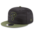 on the right side of the 2018 memorial day on-field philadelphia phillies snapback hat is the new er alogo embroidered in military green