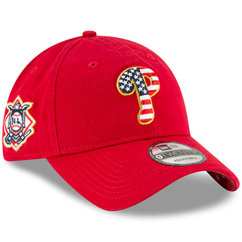 on the front of the philadelphia phillies red dad hat is the philadelphia phillies logo embroidered in stars and stripes pattern. The right side has the national league logo embroidered