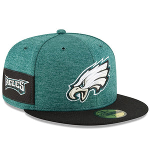 on the wearer's right side of the youth philadelphia eagles 2018 on-field sideline kid's fitted cap is the Eagles wordmark embroidered in white, black, and midnight green