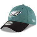 the frontof the philadelphia eagles 2018 on field sideline stretch fit cap is the philadelphia eagles logo embroidered in white, silver, black and midnight green. the wearer's left features the new era logo which is embroidered in white
