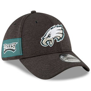 embroidered on the wearer's right side of the 2018 philadelphia eagles on field sideline home black stretch fit cap is the philadelphia eagles wordmark in white, midnight green on top of a midnight green banner