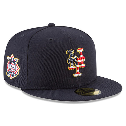on the front of the new york mets navy blue 2018 fourth of july stars and stripes fitted cap is the new york mets stars and stripes logo embroidered in red, white, and blue