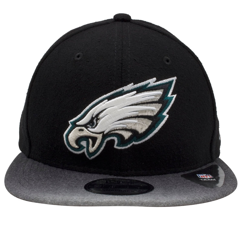 embroidered on the front of the philadelphia eagles snapback hat is the philadelphia eagles logo embroidered in white, silver, and midnight green
