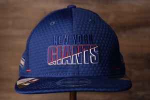 Giants 2020 Training Camp Snapback Hat | New York Giants 2020 On-Field Red Training Camp Snap Cap the front of this cap has the giant logo and the city name