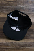 the Black Circle Patch Snapback Skater Hat | DC Shoes Black Bottom Snap Back Cap has a black underbrim