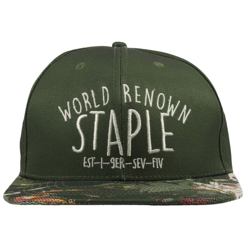 4c5a61f715a43 The front of this Camo Staple Snapback hat shows a script of World Renown  Staple embroidered