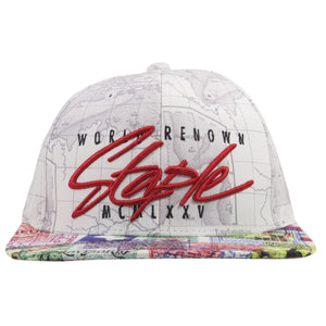 This stylish Staple Pigeon snapback hat is on a light gray snapback with a printed world map on the base of the hat.