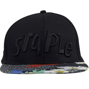 The front of this Staple Pigeon solid black hat shows the Staple word brand heavily embroidered in black.