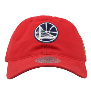 embroidered on the front of the golden state warriors red dad hat is the warriors logo in navy blue and white