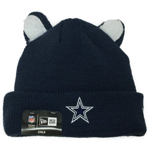 on the front of the dallas cowboys kid's sized cozy  navy plush interior winter beanie is solid navy with small ears and a navy blue dallas logo embroidered on the fron