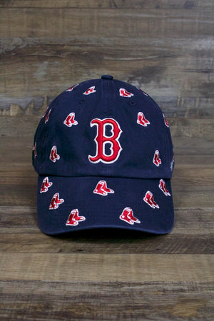 on the front of the Boston Red Sox Dad Hat | Confetti Sock Print Navy Blue Strapback Baseball Cap is a red vintage B logo and lots of tiny socks