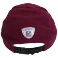 on the back of the washington redskins sideline dad hat is the nfl equipment seal above a black adjustable strap