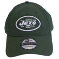 The New York Jets logo is embroidered on the front of a dark green dad hat.