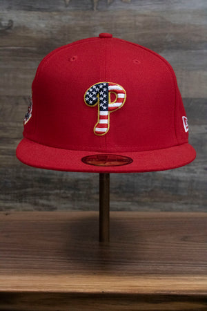 the front of the 2018 Fourth of July Philadelphia Phillies Fitted Cap | Red Stars and Stripes 4th of July Phils Fitted Hat has a Phillies P logo filled with the American flag