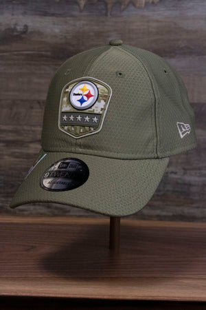 the front of the Pittsburgh Steelers 2019 Salute To Service Dad Hat | Steelers On Field Olive Green Military Inspired Baseball Cap