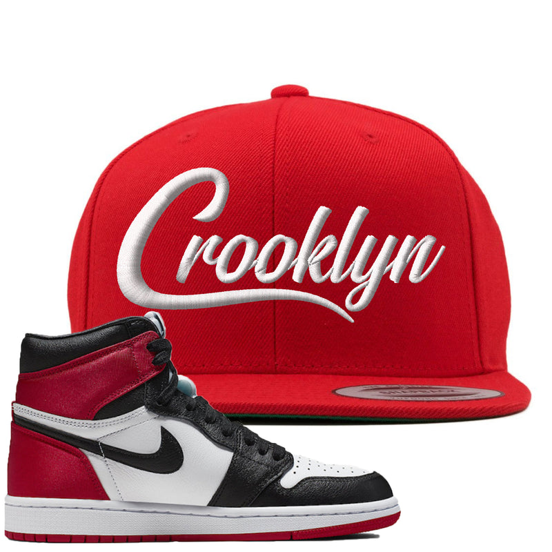 Air Jordan 1 WMNS Satin Black Toe Sneaker Hook Up Crooklyn Red Snapback