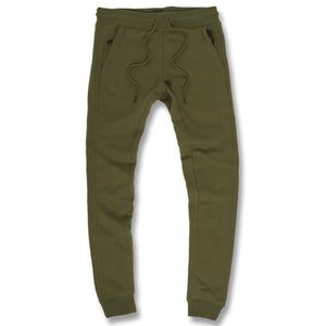 the jordan craig olive green fleece jogger sweatpants are solid green with zipper pockets