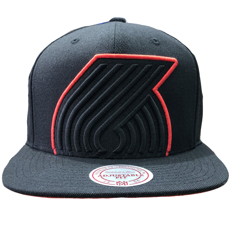 Embroidered on the front of the Portland Trail Blazers mitchell and ness snapback hat is the Portland Trailblazers logo in black and red