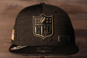 NFL Snapback | NFL 2020 Salute To Service Snap Cap | Camo Bottom | Black the front of this cap has the nfl shield on it