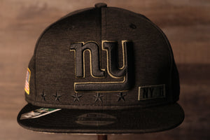 Giants Snapback | New York Giants 2020 Salute To Service Snap Cap | Camo Bottom | Black the front of this cap has the giants logo