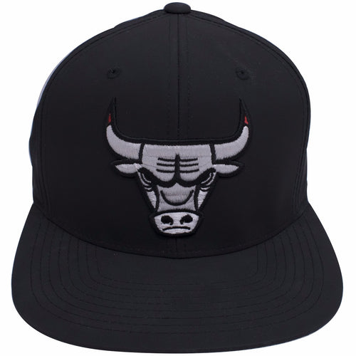 the Chicago Bulls Air Jordan 12 Neoprene Sneaker Matching Snapback Hat is solid black with a white, black, and red chicago bulls logo embroidered on the front