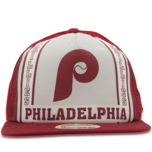 Printed on the front of the Philadelphia Phillies vintage Cooperstown trucker hat is the Philadelphia Phillies logo in maroon above the word Philadelphia and in between the word Phillies repeated twice on the edge of the front panel