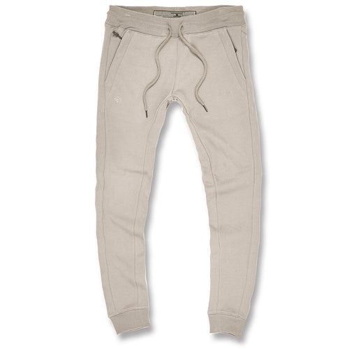 the cream colored jordan craig jogger pants are solid cream with cream adjustable strings