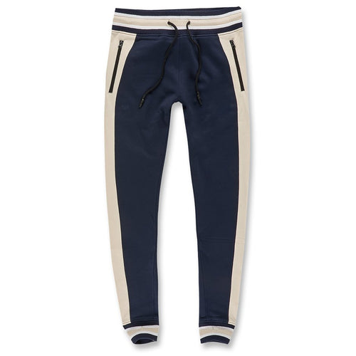 the navy blue and bone joggers are navy blue with bone accents down the side of the pantleg and across the center of the waistband