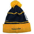 on the back of the los angeles galaxy winter knit beanie is the mitchell and ness logo embroidered in navy blue