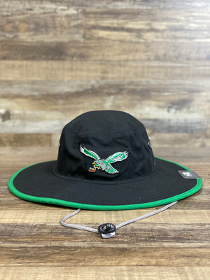 On the front of the Philadelphia Eagles Adventure Panama Bucket Hat is a vintage retro eagle logo