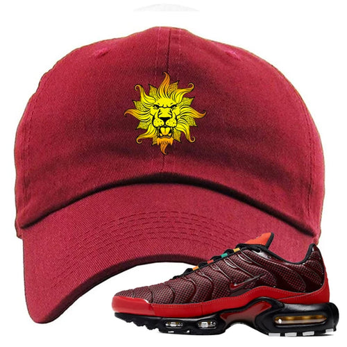 Embroidered on the front of the air max plus sunburst sneaker matching maroon dad hat is the vintage lion head logo