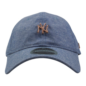 on the front of the new york yankees light denim black label dad hat is the rose gold new york yankees logo