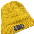 the inside cuff of the golden state mustard waffle beanie features a foot clan label