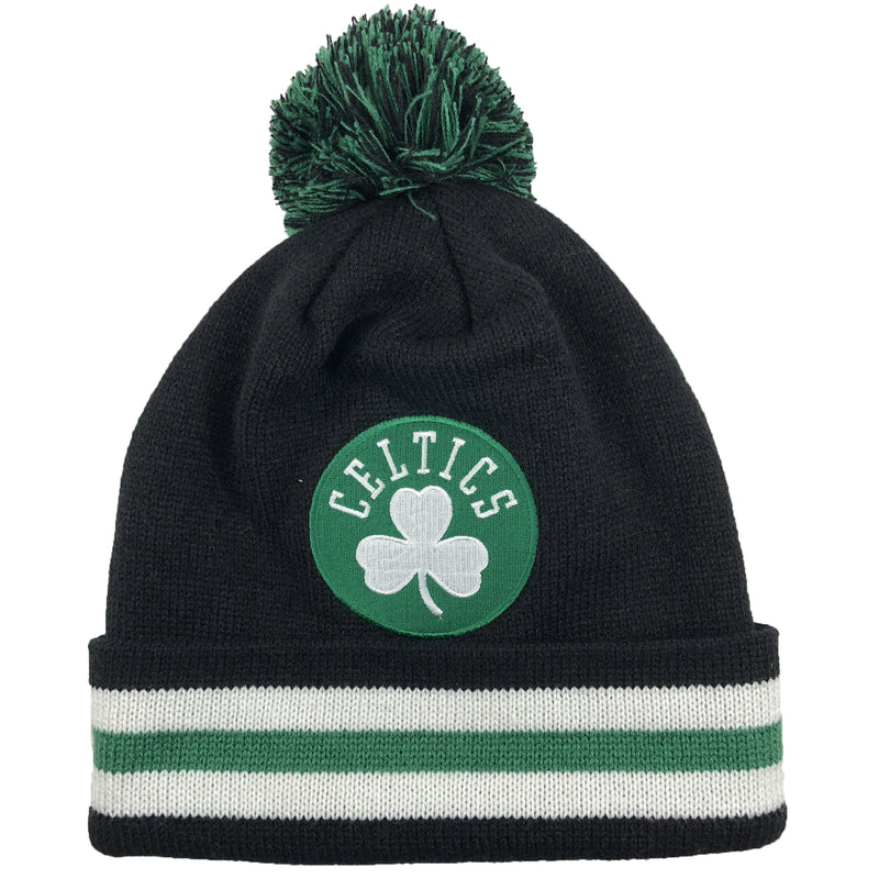 Embroidered on the front of the boston celtics thick knit winter pom beanie is the celtics logo in green and white