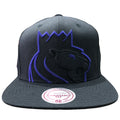 Embroidered on the front of the Sacremento Kings XL Logo snapback hat is the Sacremento Kings logo in black and purple