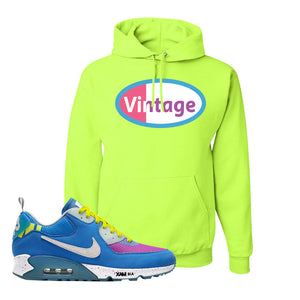 Undefeated x Air Max 90 Pacific Blue Sneaker Safety Green Pullover Hoodie | Hoodie to match Undefeated x Nike Air Max 90 Pacific Blue Shoes | Vintage Oval
